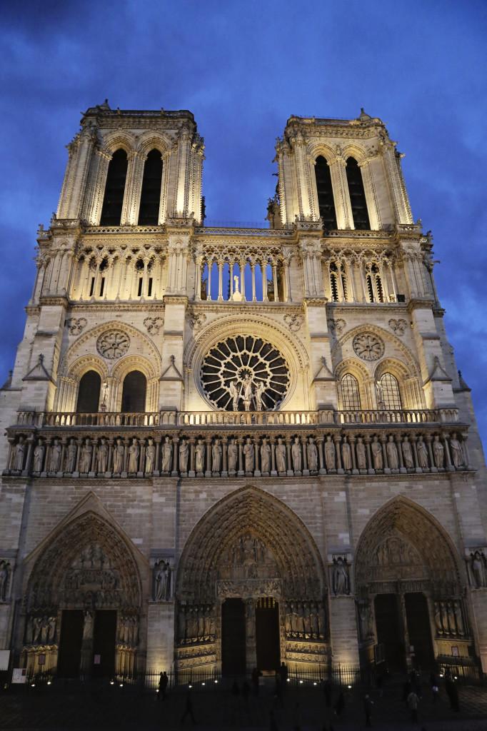 "<img alt=""Paris Notre Dame at Night""/>"